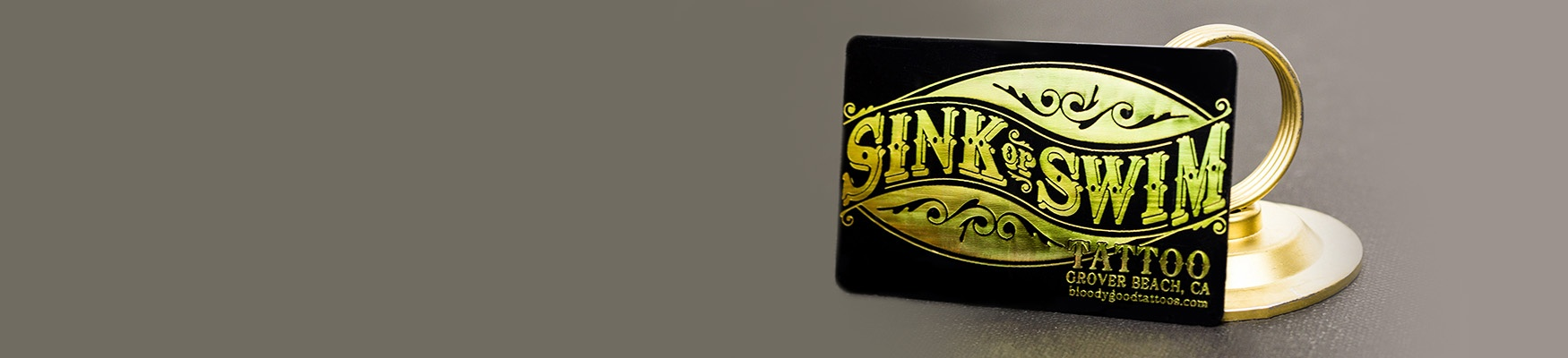 Example of Gold Foil Sink or Swim Tattoo Business Card